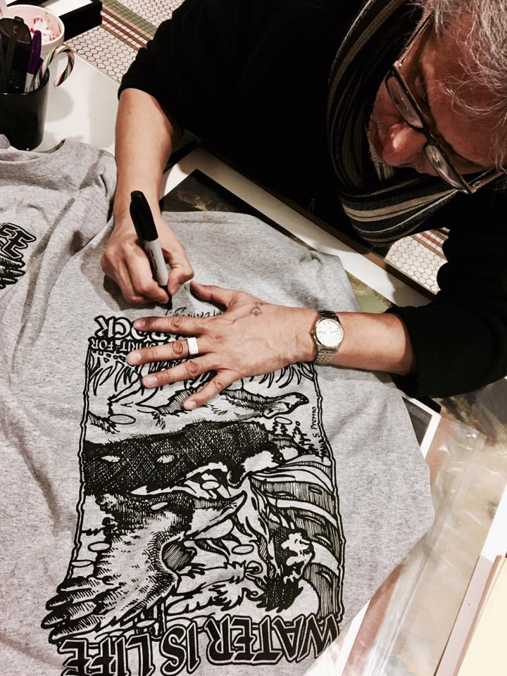 Steve Premo signs T-shirts